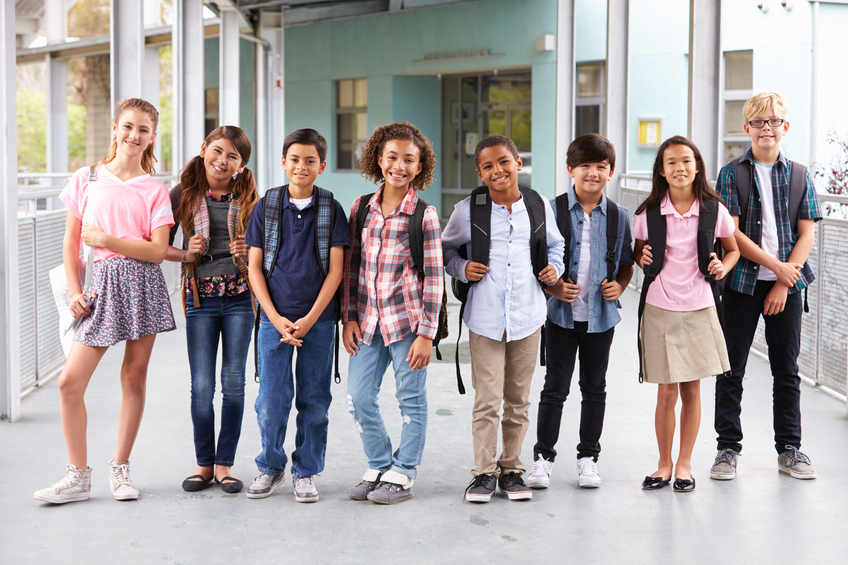Group of elementary school kids hanging out at school